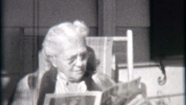 Elderly Woman Reads Magazine 1940 video