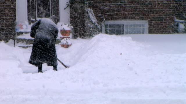 Elderly woman shovels video