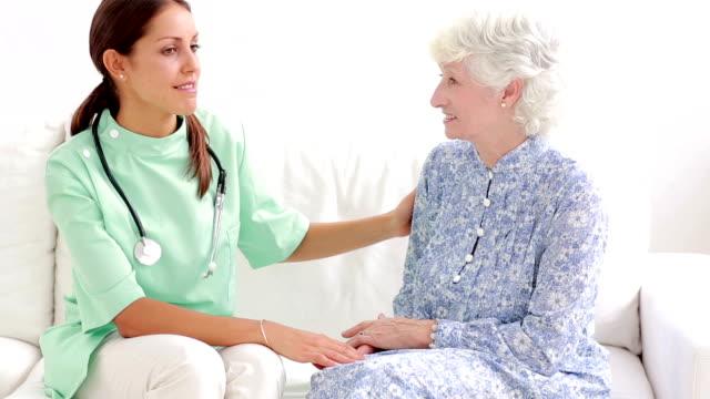 Elderly woman speaking with home nurse video