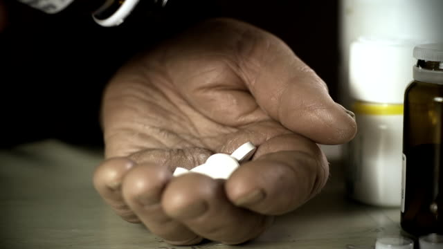 HD SLOW MOTION: Elderly Woman Spilling Pills HD1080p: SLOW MOTION CLOSE-UP shot of a senior woman spilling pills out of a pill bottle into her palm. handful stock videos & royalty-free footage