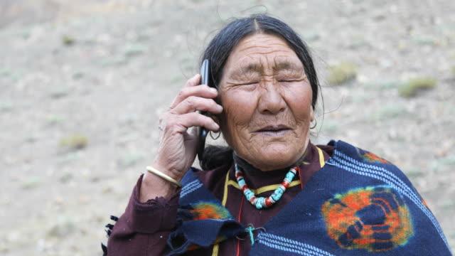 Elderly woman talking on mobile phone video