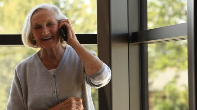 Elderly woman talking on phone video