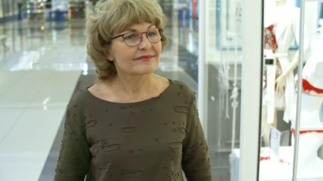 Elderly Woman Walking Through Shopping Mall video