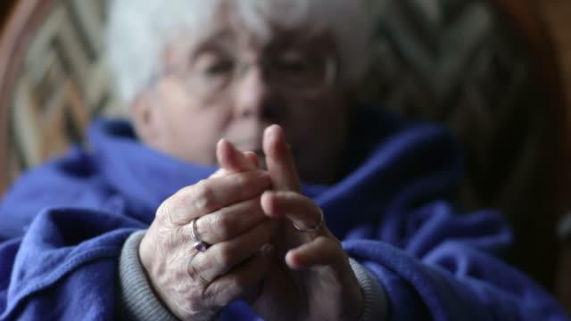 Elderly woman with arthritis video