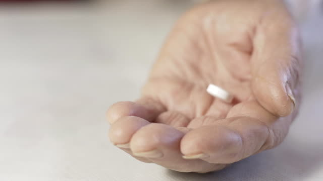 HD SLOW MOTION: Elderly Woman's Hand With Pills video