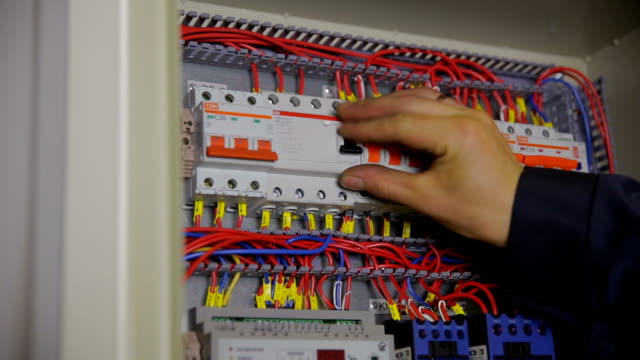 Electric Breaker Box. Electrician testing and switching fuse, breaker in a fuse box Electric Breaker Box. Electrician testing and switching fuse, breaker in a fuse box. HD. futebol stock videos & royalty-free footage
