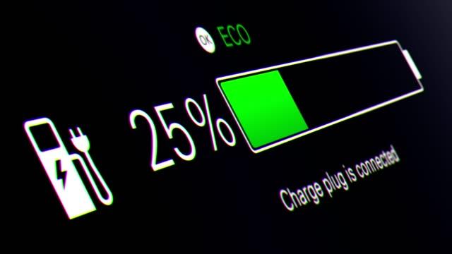 vídeos de stock e filmes b-roll de electric car dashboard. electric car battery indicator showing an increasing battery charge - carregar