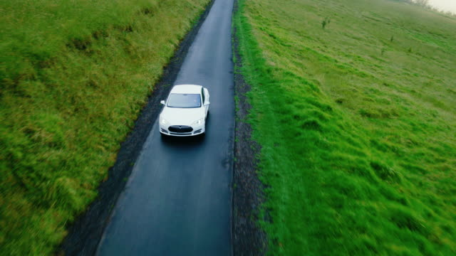 Electric Car Driving on Country Road