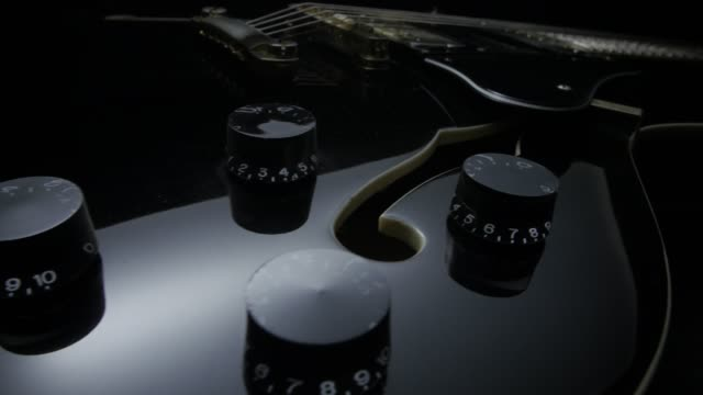 Electric Guitar On Black Background. Tracking Shot