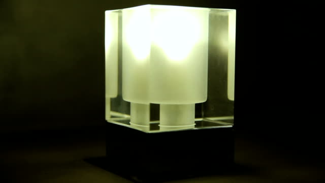 Electric lamp on a black background video