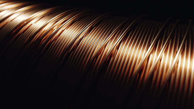 Electric motor winding from copper wire. Seamless loop. Shallow depth of field