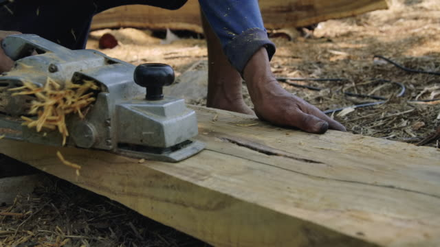 Electric Planer. Treatment of wooden planks electric tool in slow motion