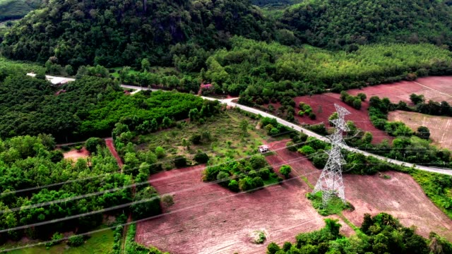 Electric power station in the field in high mountain forest 4K: High voltage transformer with forest background cable tv stock videos & royalty-free footage