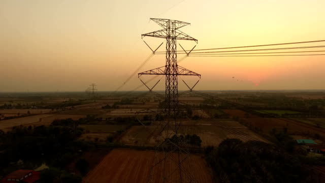 Electric power station in the field on sunset video