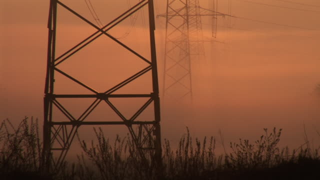 stockvideo's en b-roll-footage met hd: electric pylons at sunrise - supergeleider