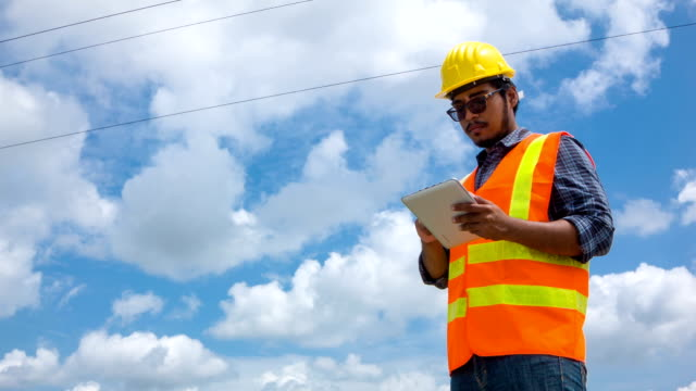 Electric worker using digital tablet video