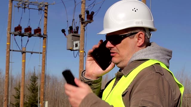 Electrical engineer talking on cell phone at outdoors video