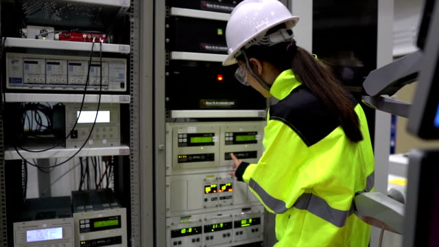 Electrical engineer woman checking voltage