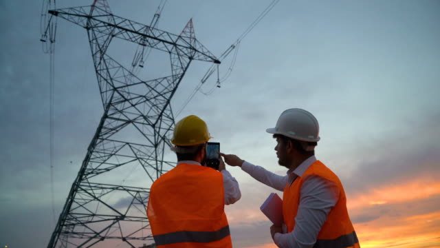 electrical engineers work on the project - cavo componente elettrico video stock e b–roll