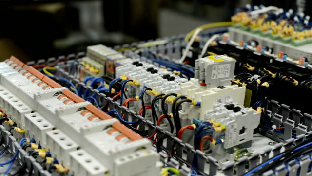 Electrical modules, switches, relays and cables are mounted on the circuit board video