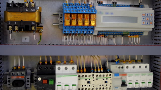 Electrical panel with multiple switches, wires, short circuit protection devices Electrical panel with multiple switches, wires, short circuit protection devices and electricity meter. Shot in motion futebol stock videos & royalty-free footage