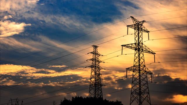 electrical pylons translation 4k uhd - sottostazione elettrica video stock e b–roll