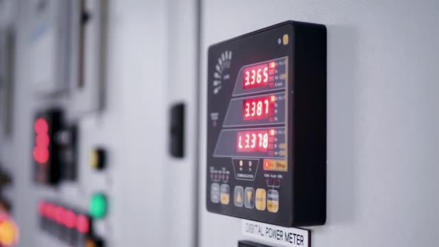 electrical transformer digital panel. - sottostazione elettrica video stock e b–roll