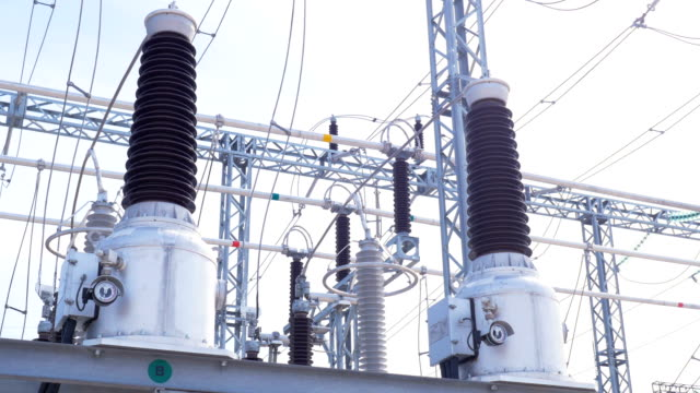 electrical transmission substation transformers Motion around powerful electrical transmission substation transformers against wires and clear blue sky station stock videos & royalty-free footage