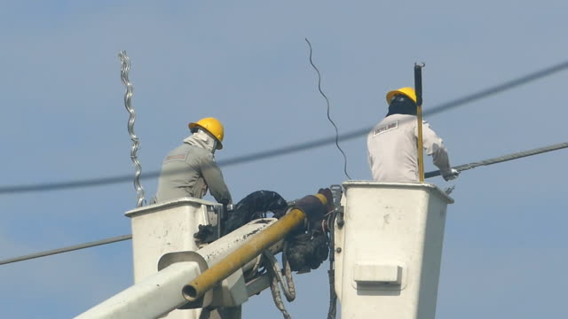 Electrician climbing a newly installed utility pole video
