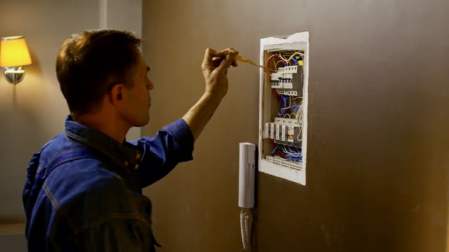 Electrician Inspecting Fuse Box video