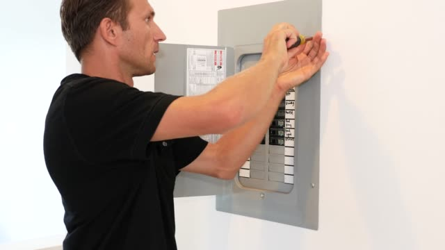 Electrician inspecting Fuse box Electrician / Repair man working with Cables at Fuse Box futebol stock videos & royalty-free footage