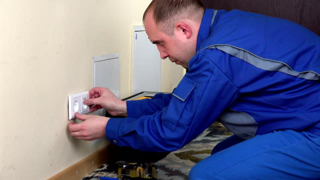 electrician man install wall power socket video