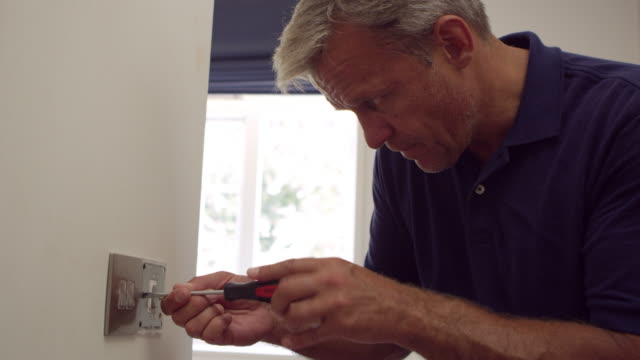 Electrician Repairing Domestic Light Switch Shot On R3D - vídeo