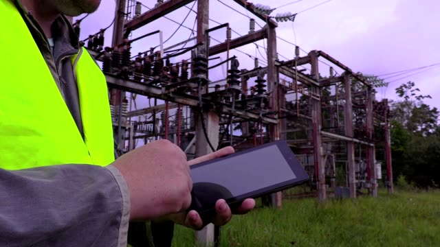 Electrician using tablet PC video