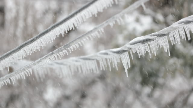 Electricity Cables Covered in Ice After Ice Storm in Winter