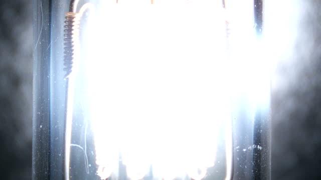 Electricity, light bulb coils light up video