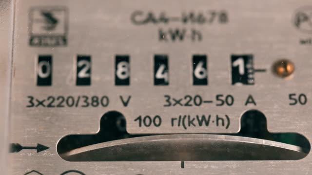 vídeos de stock e filmes b-roll de electricity meter measures the current consumed - circular economy