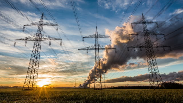 Electricity Pylons at sunset -  Time Lapse