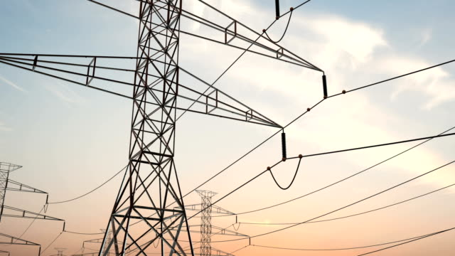 Electricity pylons. Moving along two row of pylons. electric high voltage pylon Electricity pylons. Moving along two row of pylons. electric high voltage pylon against beautiful sky. energy efficiency conception. loopable animation power line stock videos & royalty-free footage