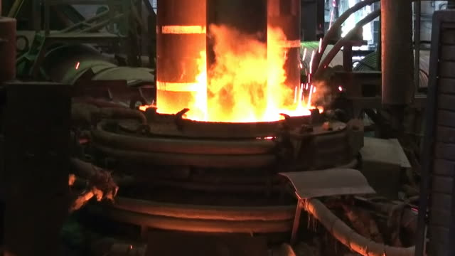 Electroarc furnace at metallurgical plant Working electroarc furnace at the metallurgical plant workshop electrode stock videos & royalty-free footage