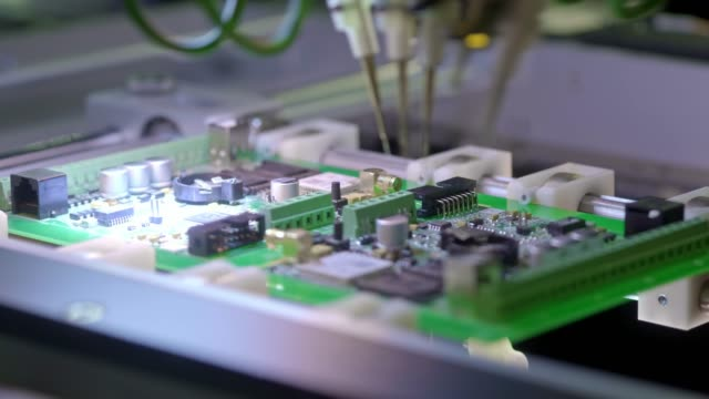 electronic circuit board production. automated circut board machine produces printed digital electronic board. electronics contract manufacturing. manufacture of electronic chips. high-tech - processore video stock e b–roll