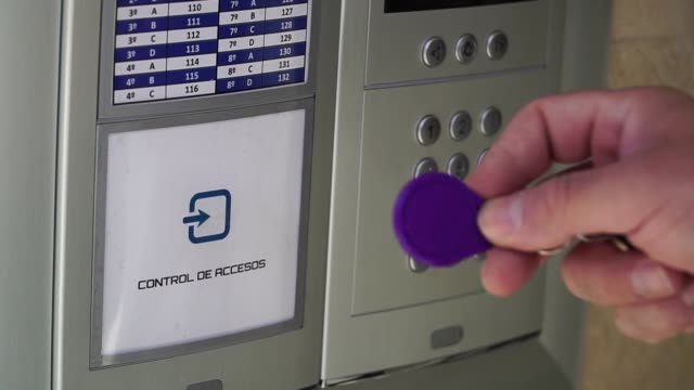 Electronic key access control. RFID tag key to open the door.