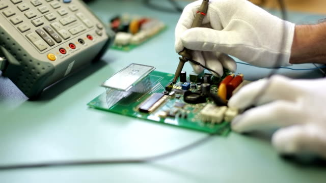 Electronics engineer configure the device Electronics engineer configure the device, measuring of electric signals with oscilloscope on dielectric table. electrical equipment stock videos & royalty-free footage