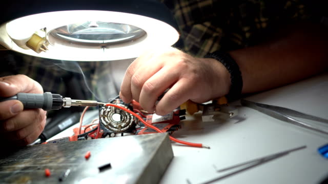 Electronics of disassembled drone repairing video