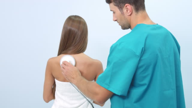 Electrostatic massage on patient's back video