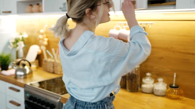 Elegant beautiful young woman in casual clothes looking for something at home in kitchen closet for storage. Looking curiously into every drawer trying to find right product to make breakfast, lunch Elegant beautiful young woman in casual clothes looking for something at home in kitchen closet for storage. Looking curiously into every drawer trying to find right product to make breakfast lunch. pantry stock videos & royalty-free footage