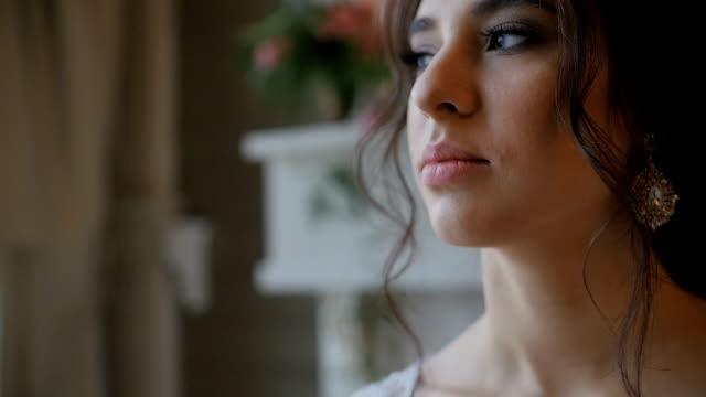 Elegant brunette bride wear beautiful earrings video