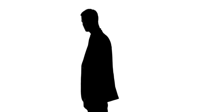 Elegant businessman in suit waiting for meeting, put hands in pockets, confident Elegant businessman in suit waiting for meeting, put hands in pockets, confident silhouette people stock videos & royalty-free footage