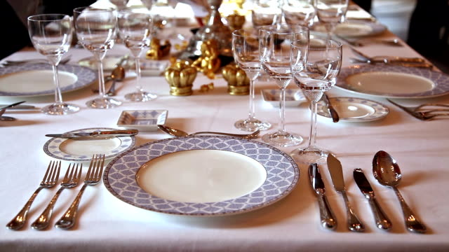 Elegant candlelight dinner table at a reception in manor house video