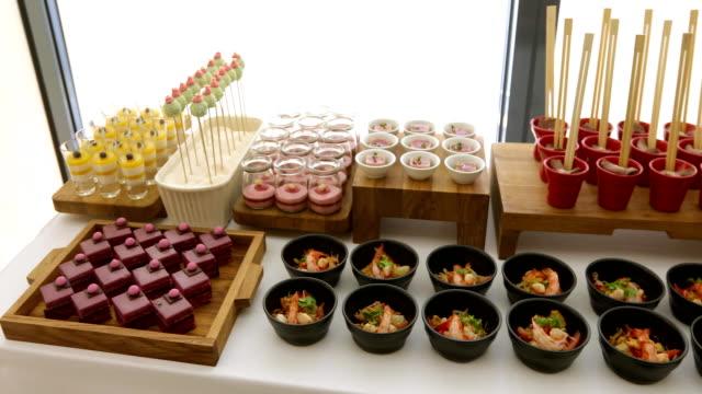 elegant colourful dessert buffet with various sweets - mestiere nella ristorazione video stock e b–roll